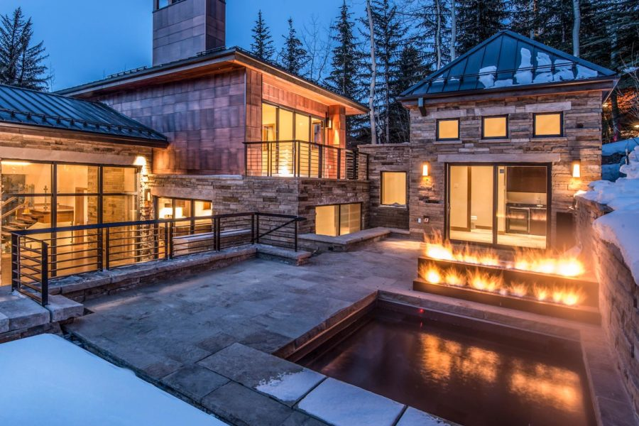 446 Forest Road, Vail, Colorado residence exterior courtyard with hot tub